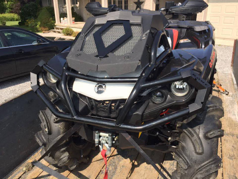 ATV with black powder coated parts in a sunny driveway.